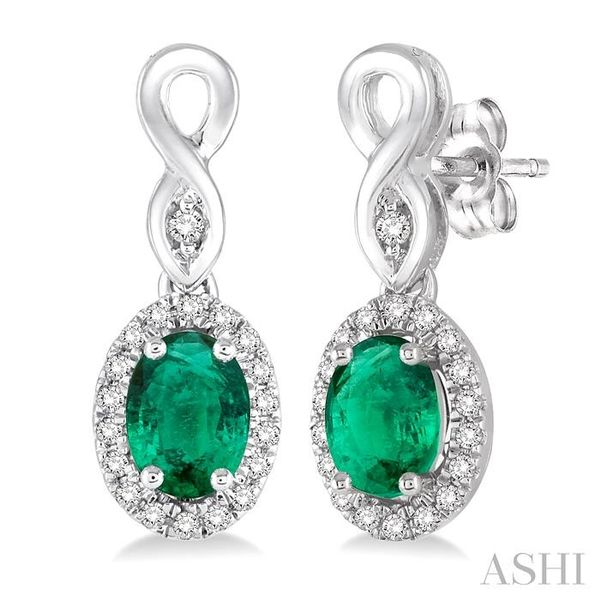 5x3 MM Oval Cut Emerald and 1/6 Ctw Round Cut Diamond Earrings in 10K White Gold Trinity Diamonds Inc. Tucson, AZ