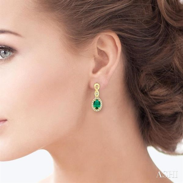 5x3 MM Oval Cut Emerald and 1/6 Ctw Round Cut Diamond Earrings in 10K Yellow Gold Image 4 Trinity Diamonds Inc. Tucson, AZ