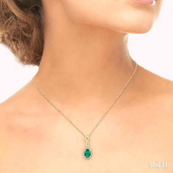 6x4 MM Oval Cut Emerald and 1/10 Ctw Round Cut Diamond Pendant in 10K Yellow Gold with Chain Image 4 Trinity Diamonds Inc. Tucson, AZ