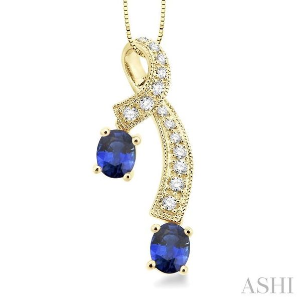 5x4MM Oval Cut Sapphire and 1/6 Ctw Round Cut Diamond Pendant in 14K Yellow Gold with Chain Trinity Diamonds Inc. Tucson, AZ