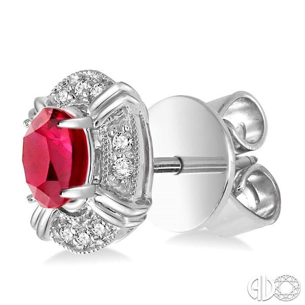 5x3 MM Oval Cut Ruby and 1/10 Ctw Single Cut Diamond Earrings in 10K White Gold Image 3 Trinity Diamonds Inc. Tucson, AZ