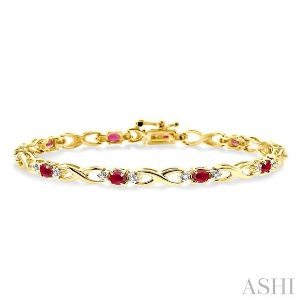 4x3mm Oval Cut Ruby and 1/10 Ctw Single Cut Diamond Tennis Bracelet in 10K Yellow Gold Trinity Diamonds Inc. Tucson, AZ